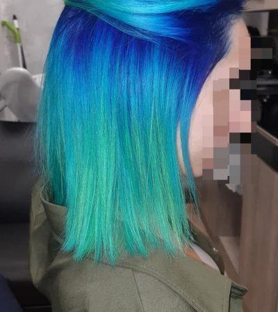 Un degradé de couleur de bleu à vert